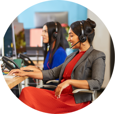 Woman at work at desk with headset on